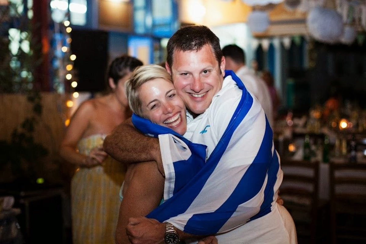 a-couple-from-cape-town-with-a-greek-flag