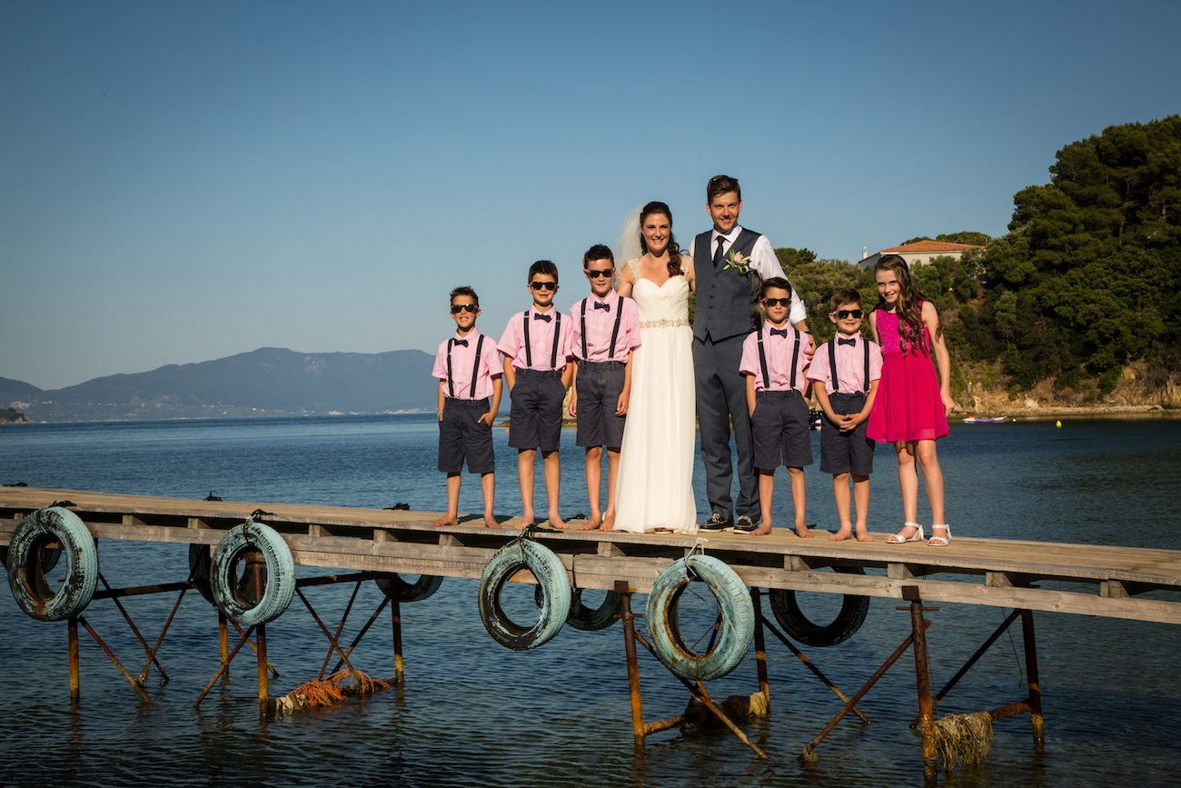 young-bridesmaids-with-the-couple-after-the-ceremony