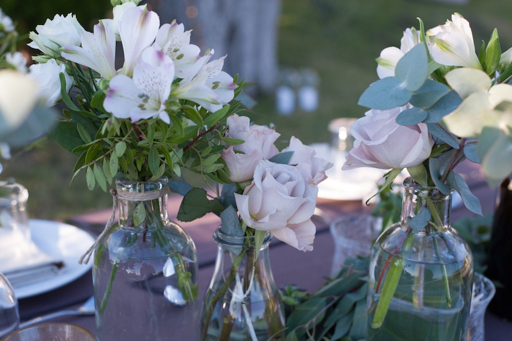 bottles-with-flowers-table-set-up
